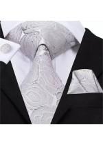 Красив комплект вратовръзка кърпичка и ръкавели с флорални мотиви в сребристо сиво
